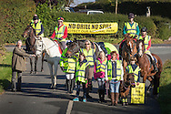 IMAGE PROVIDE FREE FOR EDITORIAL USE.<br /> Horse riders demonstrate at Forestside to illustrate the dangers for people on part of the route that would be taken by lorries and tankers every day if an oil production development is approved at Markwells Wood.<br /> The South Downs National Park is under threat of industrialisation from an application by United Kingdom Oil &amp; Gas (UKOG) who want to drill horizontal oil wells underground beside Markwells Wood at Forestside. The area is much used by horse riders and cyclists and local people are concerned about safety on the winding country roads.<br /> Picture date: Saturday October 22, 2016.<br /> Contacts for the group: are Ann Stewart : 02392 631812  or 07742096815 and Tracey Hodkin 07864 500838<br /> Photograph by Christopher Ison &copy;<br /> 07544044177<br /> chris@christopherison.com<br /> www.christopherison.com