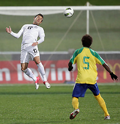 New Zealand's Kosta Barbarouses beats Solomon Islands' Freddie Kini to the ball in a FIFA World Cup Qualifier Match, North Harbour Stadium, Auckland, New Zealand, Tuesday, September 11, 2012.  Credit:SNPA / David Rowland