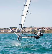 Paul Goodison, former Laser Olympic and World champion, sailing his Foiling Moth in Portland Harbour.<br /> Picture date: Sunday September 21, 2014.<br /> Photograph by Christopher Ison &copy;<br /> 07544044177<br /> chris@christopherison.com<br /> www.christopherison.com