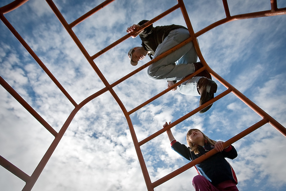 JEROME A. POLLOS/Press..Summer Sembar, 3, climbs up to her father Shawn Sembar on the jungle gym at Finucane Park in Hayden while enjoying the mild winter weather Monday. Temperatures hovered around 50-degrees as clouds moved in from the west which is expected to bring rain to the area for much of the week.