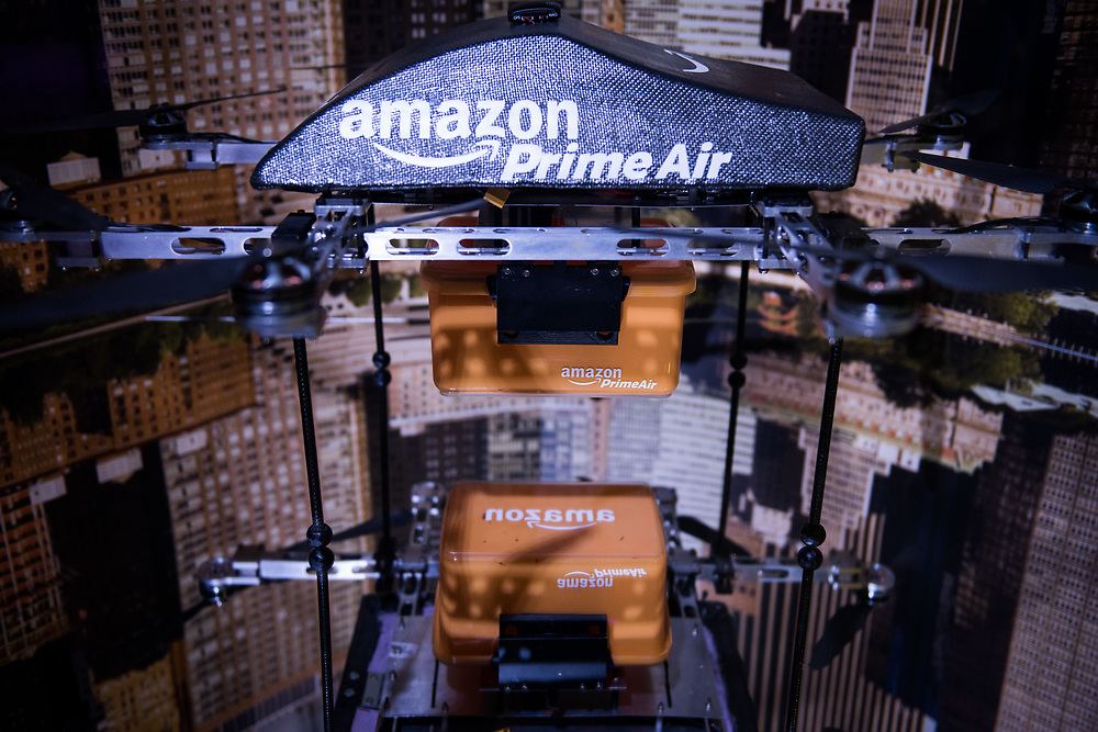 """30206010A - DRONES - An Amazon Prime Air drone sits on display at the """"Drones: Is the Sky the Limit?"""" exhibit at the Intrepid Sea, Air, and Space Museum in New York, NY on May 9, 2017. The drone can carry packages up to 5 pounds in its small box underneath."""