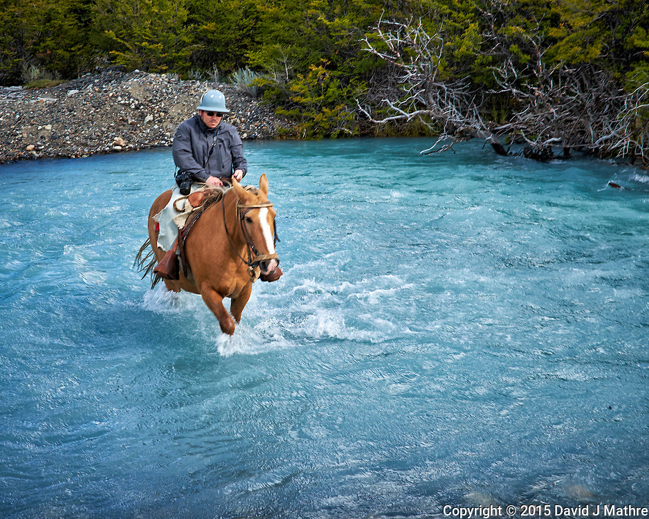 Crossing a glacier stream on a horse in Patagonia. Image taken with a Fuji X-T1 camera and  Zeiss 32 mm lens (ISO 200, 32 mm, f/11, 1/80 sec).