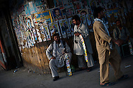 Passersby walk near campaign signs of candidates for president in Kabul, Afghanistan, August 9, 2009. The presidential election will be held on August 20.Photo By Keith Bedford