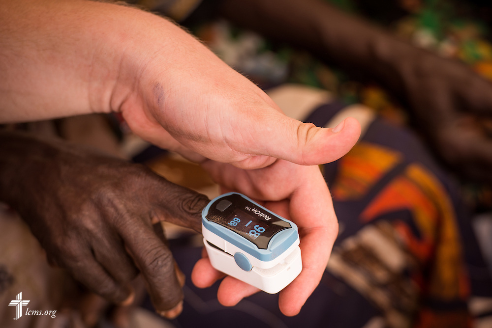 Vitals are taken from a patient during the LCMS Mercy Medical Team clinic on Monday, June 20, 2016, in Nataparkakono, a village in Turkana, Kenya.  LCMS Communications/Erik M. Lunsford