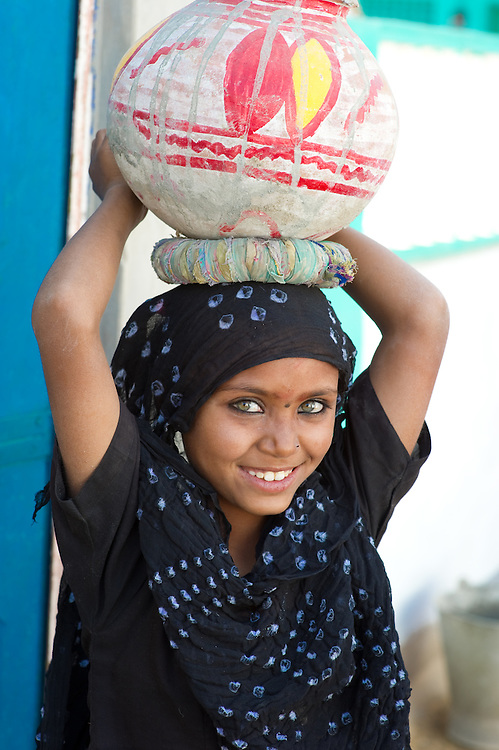In Rajasthani families, many young girls are responsible for carrying water to their houses. Sometimes, they have to walk far for a water source.