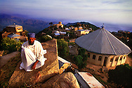 The Librarian of the Debre Bizen monastery, observes the countryside surrounding the monastery, 8,000 feet above sea level and 20kms from Asmara, the capital of Eritrea.