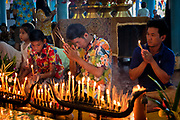 Devotees pray in the local temple as Songkran 2017 begins in rural Thailand. PHOTO BY LEE CRAKER