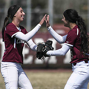 Caravel Academy Outfielder Nicole Marcon (9), RIGHT, high fives Caravel Academy Infielder Emily Proffitt (4) after making a catch during a varsity scheduled game between Caravel Academy and The Delmar Wildcats Saturday, April 4, 2015, at Caravel Athletic Field in Bear Delaware.
