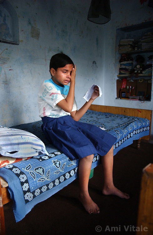 NEPALGANJ, NEPAL, APRIL 14, 2004: A Nepali girl, Sunita Bikas cries after reading a letter from her sister as she sits insidethe Sahara orphanage in Nepalganj, Nepal April 14, 2004.  She was orphaned because of the Maoist insurgency that has killed nearly 10,000 people since 1996, 2000 of them being children.  (Ami Vitale/Getty Images)