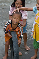 Children play with a tire in Central Sulawesi