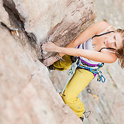 Danielle Forrester on First Impressions, 5.9, at Little Eiger in Clear Creek Canyon, Golden, CO. Kris Ugarriza - Red Wave Pictures
