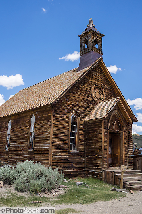 """Methodist Church at Bodie, California's official state gold rush ghost town. Bodie State Historic Park lies in the Bodie Hills east of the Sierra Nevada mountain range in Mono County, near Bridgeport, California, USA. After W. S. Bodey's original gold discovery in 1859, profitable gold ore discoveries in 1876 and 1878 transformed """"Bodie"""" from an isolated mining camp to a Wild West boomtown. By 1879, Bodie had a population of 5000-7000 people with 2000 buildings. At its peak, 65 saloons lined Main Street, which was a mile long. Bodie declined rapidly 1912-1917 and the last mine closed in 1942. Bodie became a National Historic Landmark in 1961 and Bodie State Historic Park in 1962."""