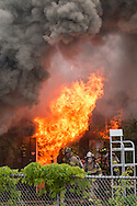 Flames shoot out of an abandonded building as firefighters arrive on the scene at the former Middletown Psychiatric Center in Middletown, New York.