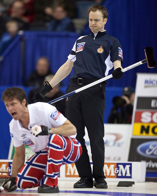 Scottish skip Tom Brewster, right, reacts to a shot as Norway skip Thomas Ulsrud encourages his sweepers during their semi-final at the Ford World Men's Curling Championships in Regina, Saskatchewan, April 9, 2011.<br /> AFP PHOTO/Geoff Robins