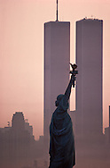 Statue of Liberty Between Twin Towers, World Trade Center at sunrise, New York City, New York, designed by Minoru Yamasaki, aerial