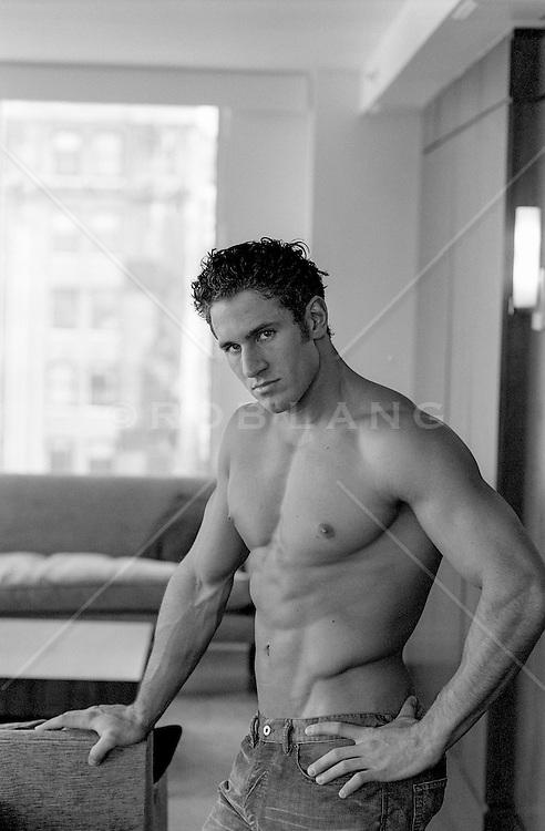 muscular shirtless man at home