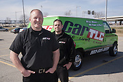 Kevin Hanson, owner of Car TLC, with technician Aaron Mussler, right, work on cars on location, as seen here in a downtown parking lot Thursday, March 14, 2013 in Louisville, Ky. (Photo by Brian Bohannon)