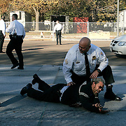 US Secret Service officers surround a man who set himself on fire outside of the White House Monday, November 15, 2004...Photo by Khue Bui