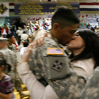 A husband and wife are reunited at a ceremony welcoming  U.S. Army soldiers returning from duty in Iraq at Fort Carson in Colorado Springs, Colorado February 12, 2009.  About 280 soldiers from the 3rd Brigade Combat Team, 4th Infantry Division returned following their 15-month deployment to Iraq.  REUTERS/Rick Wilking (UNITED STATES)
