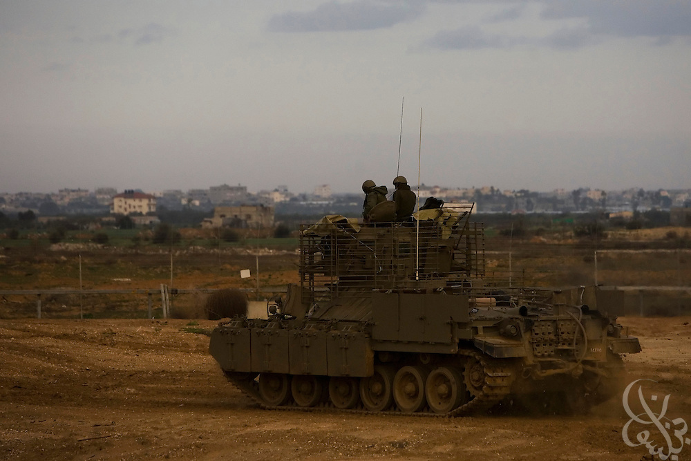 An Israeli Defense Force (IDF) armored personnel carrier moves toward the Israeli-Gaza border during the ongoing Operation Cast Lead January 8, 2009 at the Sufa Crossing. The operation has entered its 13th day, despite truce efforts from a host of nations including France, Egypt and the United States.