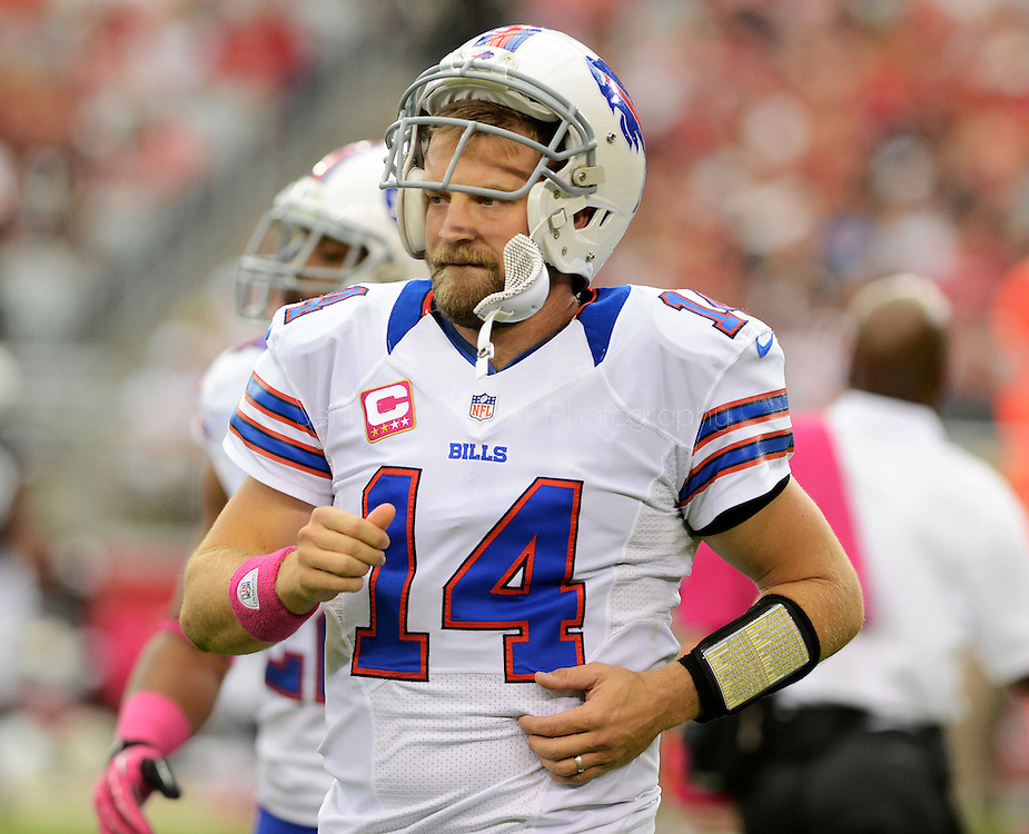 Oct. 14, 2012; Glendale, AZ, USA; Buffalo Bills quarterback Ryan Fitzpatrick (14) runs off the field during the first half against the Arizona Cardinals at University of Phoenix Stadium. Mandatory Credit: Jennifer Stewart-US PRESSWIRE
