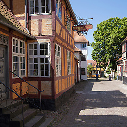 Standing in the yard you feel like you are in Faaborg in the eighteenth century. At that time, the city was the nr. 5. of the biggest maritime cities in the country, and the main streets where characterized by the big merchants houses.