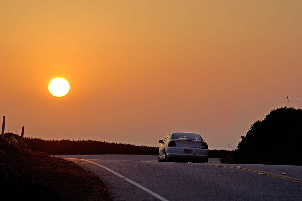Sunset behind car, Highway 1, Cabrillo Highway, Big Sur, California, United States of America