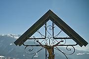 Old crucifix overlooking the Italian Alps of Carnia.