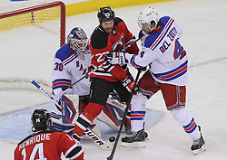 May 19, 2012; Newark, NJ, USA; New York Rangers goalie Henrik Lundqvist (30) makes a save through a screen by New Jersey Devils right wing David Clarkson (23) while New York Rangers defenseman Michael Del Zotto (4) defends during the first period in game three of the 2012 Eastern Conference Finals at the Prudential Center.