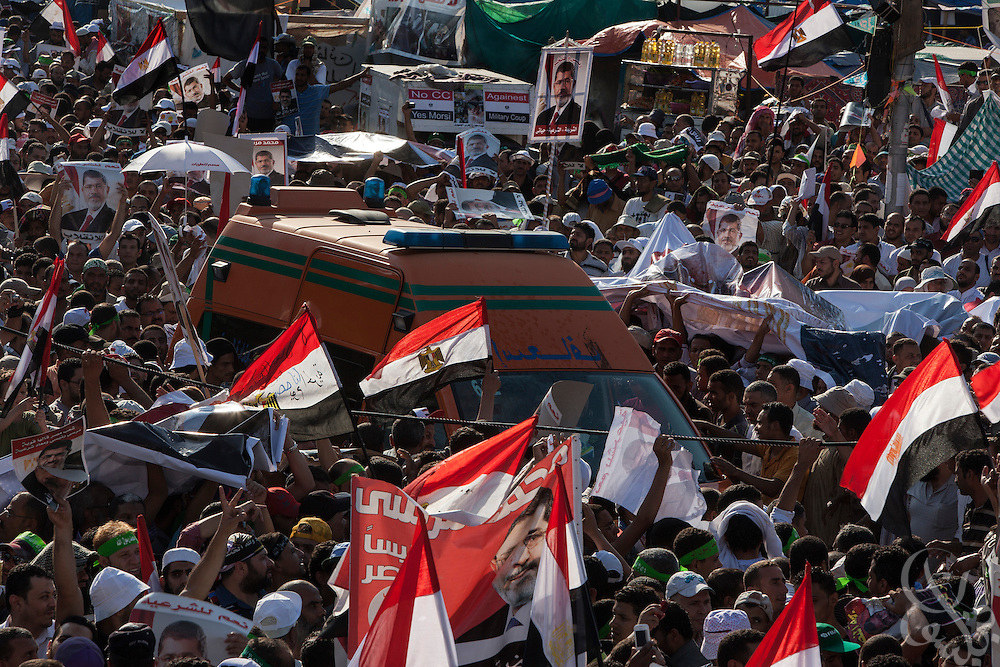 Supporters of deposed Egyptian president Mohamed Morsi continue their month long, large scale demonstrations and sit-in around the Rabaah al-Adawia mosque and square in the Nasr City district of Cairo Friday July 26, 2013.  The supporters are demanding the reinstatement of the deposed President and are opposed to the Egyptian military, which they say has undertaken an undemocratic coup.