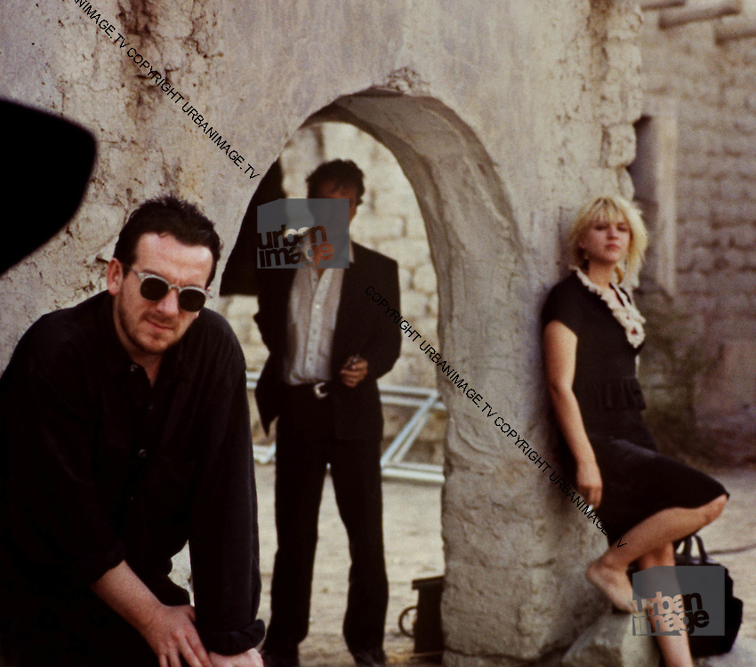 Elvis Costell, Courtney Love and Joe Strummer on set. Straight to Hell.