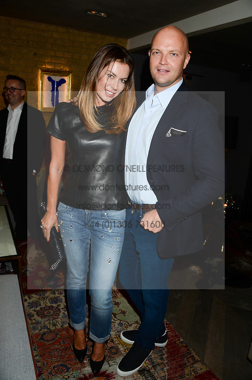RUSLAN & KATYA FOMICHEV at the Launch of Pont St Restaurant at Belgraves Hotel, 20 Chesham Place, London SW1 on 10th September 2013.