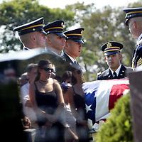 (09/28/06-Swampscott,MA) The funeral of Army Soldier Jared Raymond, age 20. Here, mourners are reflected at Swampscott cemetery.(092806raymondmg-Staff Photo:Mark Garfinkel.saved phto6/fri),