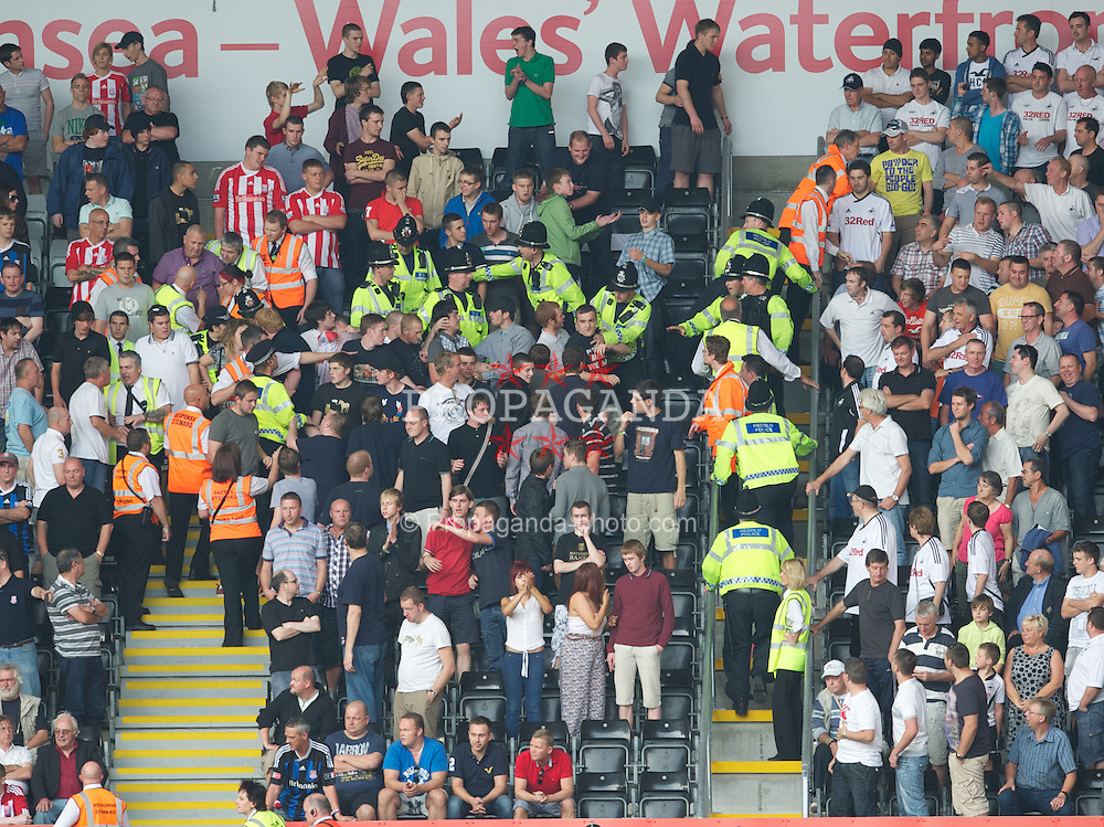SWANSEA, WALES - Sunday, October 2, 2011: Stoke City supporters clash with police and stewards during the Premiership match against Swansea City at the Liberty Stadium. (Pic by David Rawcliffe/Propaganda)