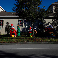 CELEBRATION, FL -- December 2, 2010 -- Inflatable Christmas decorations line the street in the small, Disney master-planned community in Celebration, Fla., on December 2, 2010.  The town's first murder in its 14 year existence has drawn buzz worldwide and amongst its citizens alike.