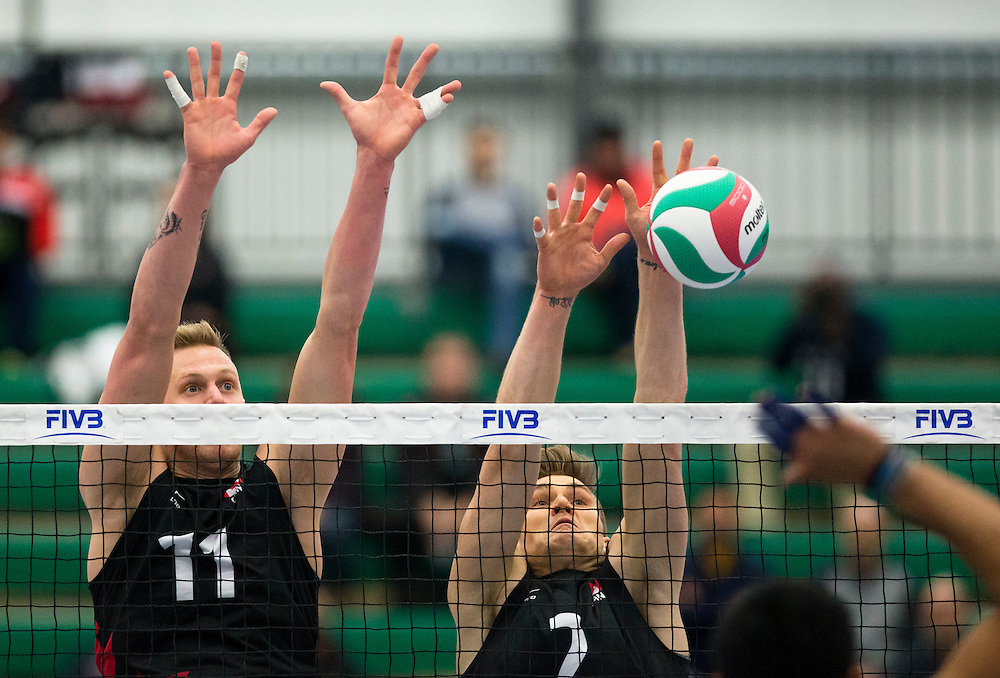 Daniel Cornelius Jansen Vandoorn (11) and John Gordon Perrin of Canada attempts to block a Mexican spike during the Men's NORCECA Continental Olympic Qualification Tournament at the Saville Community Sports Centre in Edmonton, Alberta on January 8, 2016. The winner of the event will go to the 2016 Olympic Games in Rio de Janeiro.