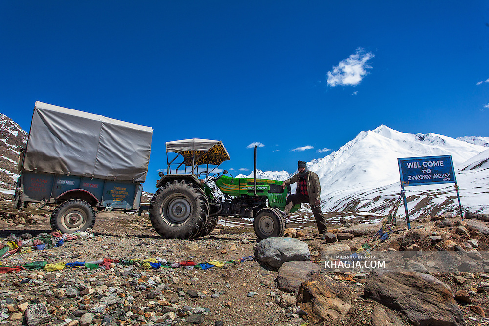 Jaibir Singh Virk poses with the tractor at Pensi La Pass on Kargil-Padum road...In May 2012, Fox Adventure Club set a record for the Longest Tractor Expedition, when three members covered 3623 kms across the western Himalayas in just 14 days on a 65hp Farm Tractor.