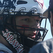 Caravel Academy Catcher Colin Adams (15) speaks to Caravel Academy Manager Paul Niggebrugge in the first inning during a regular season baseball game between the St. Marks Spartans and Caravel Academy at St. Marks Stadium Thursday April 14, 2016 in Wilmington.
