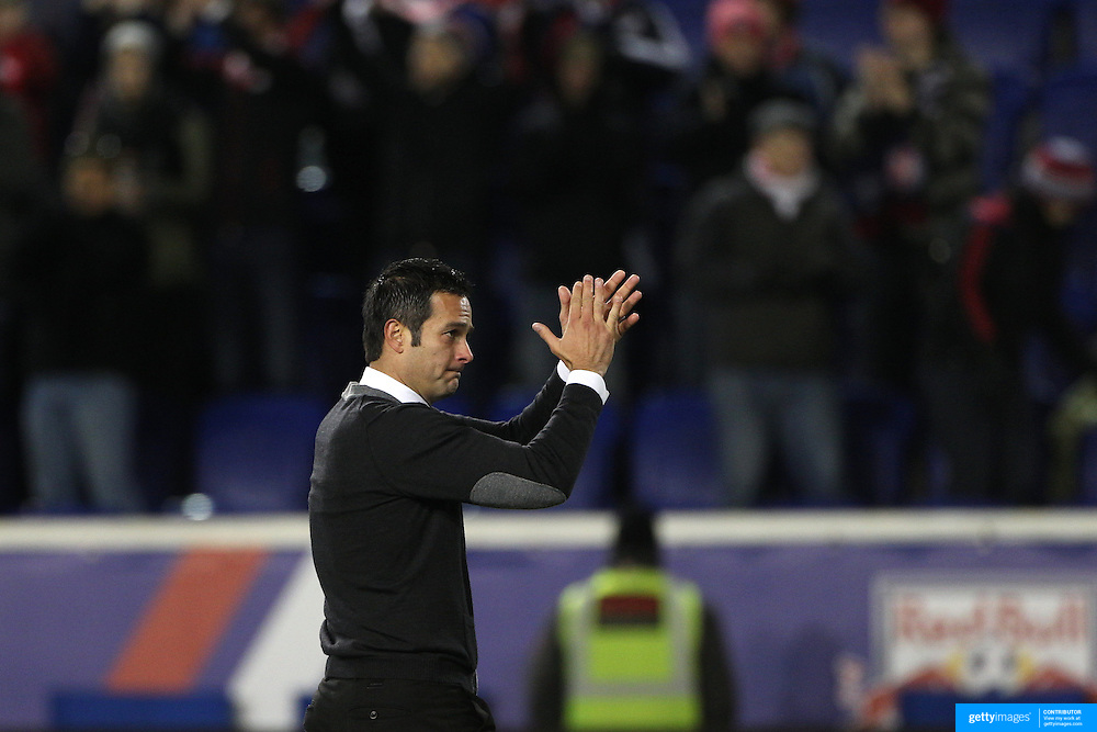 New York Red Bulls coach Mike Petke salutes the fans after his sides 2-0 win during the New York Red Bulls V DC United, MLS Cup Playoffs, Eastern Conference Semifinals first leg at Red Bull Arena, Harrison, New Jersey. USA. 2nd November 2014. Photo Tim Clayton