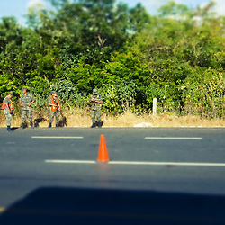 Several soldiers congregate at a roadside checkpoint south of Cancun, Mexico.