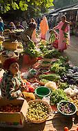Nuns shopping for food at Mandalay market, Burma