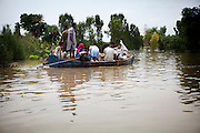 Muzzafargarh: Families hitch a ride on a boat fleeing rising floodwater near the town of Baseera in the district of Muzzafargarh...Flood waters continued to cause havoc in South Punjab.