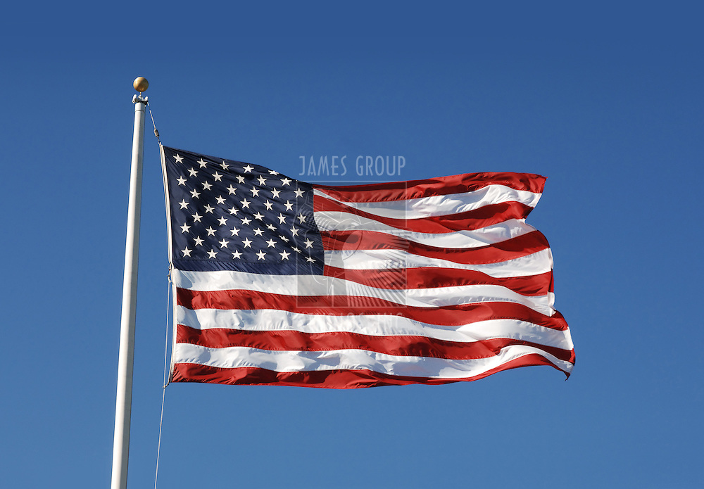waging US flag against blue sky