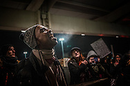 Protester leads a call and response chant at the Anti-Trump rally at John F. Kennedy International Airport, after the Trump administration implemented a ban on entry to citizens of 7 Muslim-majority nations into the United States.  New York, New York, USA.  28 January 2017