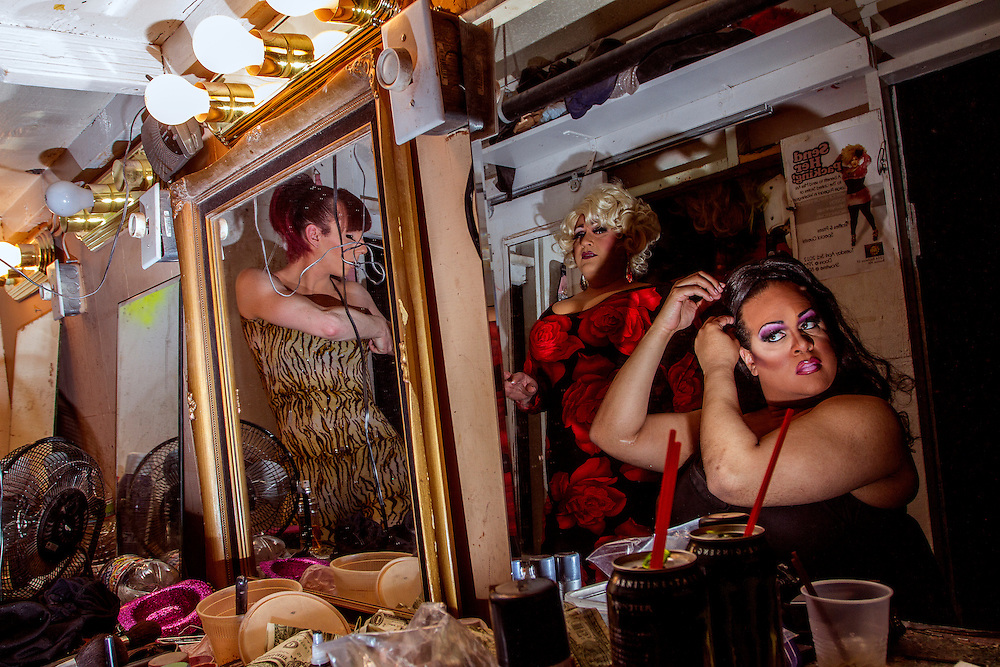 Drag Queens get ready at at backstage for a show at Jacques Cabaret in Bay Village neighborhood of Boston, MA USA on April 30, 2012.  Seen in photos are Karisma Jackson Tae, Miss Chris (red dress) and Nikki (R-L)<br /> Jacques Cabaret (EST: 1931) is the oldest drag queen live cabaret in Boston, MA USA.