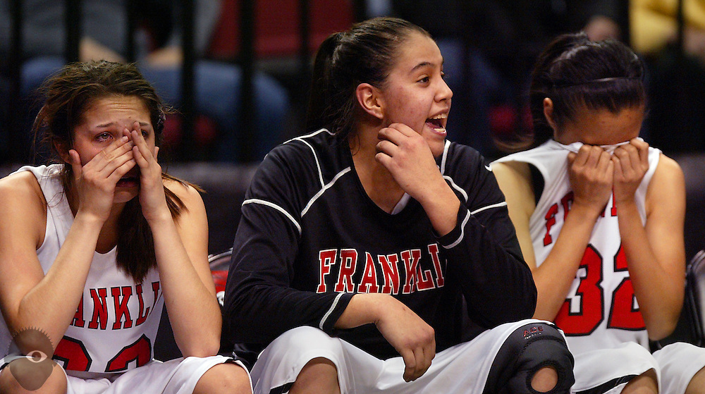 03/10/2010 - Franklin's Jude Schimmel (22) watches weeping from the bench as her older sister Shoni Schimmel (23) cheers on teammates as the game winds down and both have fouled out. Other teammate Lisa Chiem (32) is emotional as well. Jesuit beat Franklin 83-70 in the 2010 OSAA 6A Girls Basketball State Playoffs from the Rose Garden.