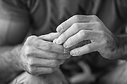 The strongest fingers in the world? Chris Sharma's hands resting below his route Bon Combat at Cova de Ocell near Barcelona Spain