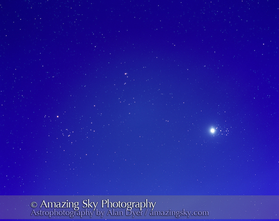 Venus beside Pleiades cluster on April 3, 2004, with hyades cluster in Taurus to the left of frame. Mars also in frame at top centre. ..165mm f/2.8 telephoto lens, tracked on equatorial mount for 4 minute exposure on Fujichrome 100F film, on 6x7 format. Taken in near full moonlight. Sky darkened in Photoshop. Light cloud added haze around Venus.