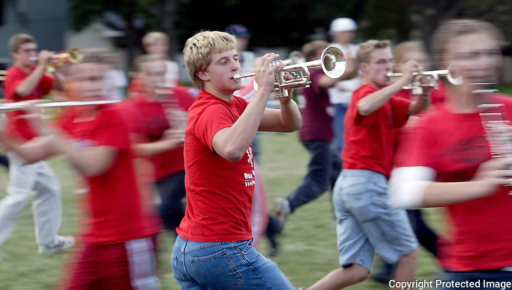 """Junior trumpet player Curtis Bomgaars, center, moves swiftly with the rest of the MOC Floyd Valley band as they rehearse """"Whirlwind"""", a field competition piece of music which is built on momentum.  The purpose of the show is to """"shake up audiences and bands everywhere."""" wrote Peter Connell, son of band director Steve Connell, who conceived of and wrote the music.  """"I want ooohhhhss...ahhhhhhsssss...wooooooeeeeeessss... heads turning, jaws dropping."""""""