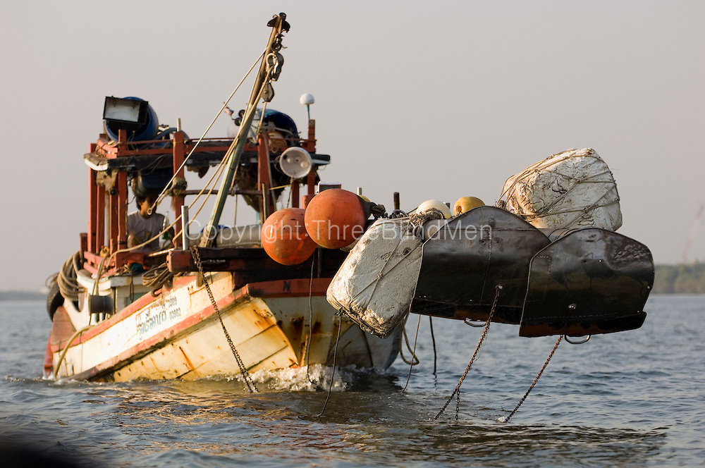 Large fishing boat heading out into the Gulf of Thailand. Samuthprakarn...Samuthprakarn also known as Pak Nam, is located 29 kilometers south of Bangkok on the east bank of Chao Phraya River near its estuary into the Gulf of Thailand.